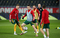 LEUVEN, BELGIUM - Wednesday, March 24, 2021: Wales' captain Gareth Bale (C) and his Tottenham Hotspur team-mate Joe Rodon (L) during the pre-match warm-up before the FIFA World Cup Qatar 2022 European Qualifying Group E game between Belgium and Wales at the King Power Den dreef Stadium. Belgium won 3-1. (Pic by Vincent Van Doornick/Isosport/Propaganda)