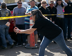An unidentified contestant in the Spam toss competition can't get a grip on the slimy meat loaf at the 22nd annual Spam Festival, Sunday, Feb. 16, 2019, in Isleton, Calif. Spam lovers competed for prizes by presenting their favorite Spam-infused foods, or entering the Spam-eating and Spam-toss contests. (Photo by D. Ross Cameron)