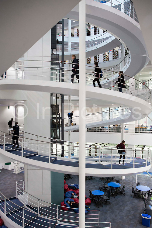 Students walking on the central stairway of the main LSE library designed by Norman Foster.  The London School of Economics and Political Science LSE. Westminster, Central London. One of the leading social science universities in the world with students attending from over 155 different nations.