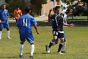 Fabian Lopez (#16) of Deportivo Colomex blocks for posession against Team Shlama F.C. during National Soccer League play in Skokie, Il.