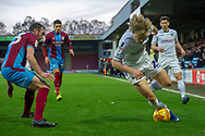 Wycombe Wanderers forward Alex Samuel (25) stumbles over the ball as he tries to beat the Scunthorpe United defense during the EFL Sky Bet League 1 match between Scunthorpe United and Wycombe Wanderers at Glanford Park, Scunthorpe, England on 29 December 2018.