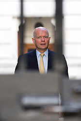 "© Licensed to London News Pictures. 29/08/2013. London, UK. William Hague, the Foreign Secretary arrives for a meeting of the British cabinet on Downing Street in London today (29/08/2013) as a recalled British Parliament prepares to debate the possibility of ""direct"" military action over recent reports an alleged chemical weapons attack in Syria. Photo credit: Matt Cetti-Roberts/LNP"