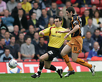Photo: Lee Earle.<br /> Watford v Wolverhampton Wanderers. Coca Cola Championship. 29/10/2005. Watford's matthew Spring (L) battles with Wolves captain Mark Kennedy.