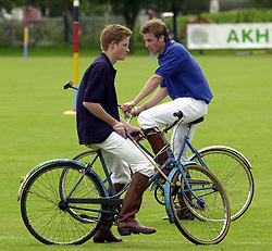 File photo dated 13/7/2002 of Prince Harry on the Eventers team and Prince William on the Jockeys team take a break whilst playing in the bicycle part of the Jockeys v Eventers Charity polo match at Tidworth Polo Club, Wiltshire. Prince Harry has asked his brother the Duke of Cambridge to be his best man at his wedding to Meghan Markle, Kensington Palace said.