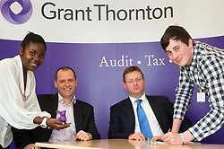 """Grant Thornton Business Awareness Day Chikumo Fiseko of Longley Park 6th form College (right) and James Boreman of Silverdale School (right) make their pitch to The Grant Thornton """"Dragons"""" Jamie Preston senior Tax Manager (seated left) and Paul Houghton Partner (seated right)..http://www.pauldaviddrabble.co.uk.4 April 2012 .Image © Paul David Drabble"""