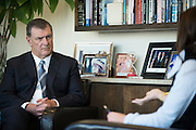 Dallas Mayor Mike Rawlings visits with a constituent at City Hall in Dallas, Texas on November 18, 2016. (Cooper Neill for The New York Times)