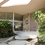 """Developer Robert Alexander built this mid-century modernism estate in the early 60s, the home was later leased to Elvis Presley in 1966 for one year as a """"Honeymoon Hideaway"""" for himself and Priscilla. The home has been restored and is available for tours."""