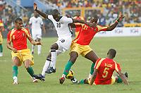 Photo: Steve Bond/Richard Lane Photography.<br />Ghana v Guinea. Africa Cup of Nations. 20/01/2008. Quincy Owusu-Abiyie (CL) is tackled by Daouda Jabi (CR). Bobo Balde is grounded (R)
