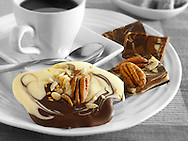 Chocolate swirl biscuits with nuts and fruit and coffee
