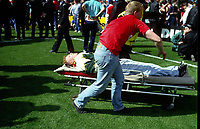 A Liverpool Fan is Stretchered away to a Ambulance<br />