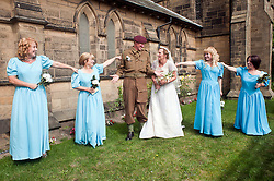 Dressing off Kaths Bridesmaids fall in for the pictures at the 1940's Wedding of Reenactors Andy Hacking and Kath Hacking (nee Plummer) held at Saint John The Divine Church Lytham. Both members of the  Northern World War 2 Association Andy  and Kath chose to tie the knot surround by family and friends during the Lytham 1940's war weekend.19 August 2011  Image © Paul David Drabble