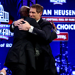 06 February, 2010: Former teammates Jerry Rice and Steve Young hug on stage after Rice was announced as one of the newest Enhrinees into the Hall of Fame during a press conference for the Pro Football Hall of Fame Class of 2010 Enshrinees held at the Greater Ft. Lauderdale/Broward County Convention Center in Fort Lauderdale, Florida.