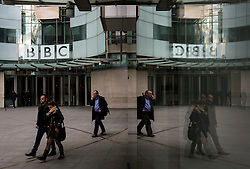 © Licensed to London News Pictures. 25/02/2016. London, UK. A reflection in a window of the front entrance to BBC Broadcasting House in London where a report in to abuse by DJ Jimmy Savile has been released. The Dame Janet Smith review found that the BBC repeatedly failed to stop abuse by DJ Jimmy Savile and broadcaster Stuart Hall. Photo credit: Ben Cawthra/LNP