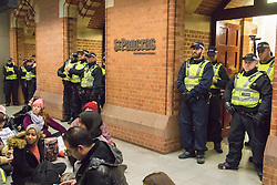 "St Pancras, London, January 16th 2016. Dozens of protesters hold an ""emergency demonstration and die-in"" as France prepares to bulldoze the Jungle Camp at Calais. PICTURED: Police block the entrance to the Eurostar terminal as protesters stage a sit-in. ///FOR LICENCING CONTACT: paul@pauldaveycreative.co.uk TEL:+44 (0) 7966 016 296 or +44 (0) 20 8969 6875. ©2016 Paul R Davey. All rights reserved."