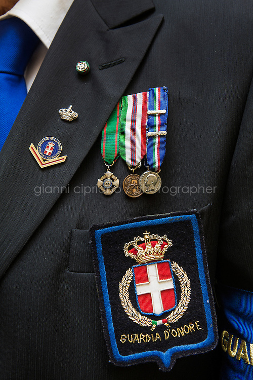 ROME, ITALY - 29 JULY 2014: Pins, medals and signs of the Honor Guards to the royal tombs of the Pantheon, in Rome, Italy, on July 29th 2014.<br /> <br /> The National Institute for the Honor Guards to the royal tombs of the Pantheon is a monarchic-oriented whose goal is to watch over the royal tombs at the Pantheon. Italy's first king, Vittorio Emanuele II and his son Umberto I, as well as Umberto's wife Queen Margherita are entombed in the Pantheon.