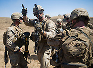 Sgt. Thomas Fowlkes directs his team after hitting the ground during live-fire exercises for the 2nd Battalion, 5th Marine Regiment at Camp Pendleton.