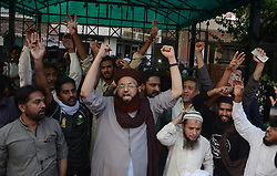 October 12, 2017 - Lahore, Punjab, Pakistan - Dr. Muhammad Ashraf Asif Jalali leader of a religious group Tehreek-e-Sirate Mustaqeem Pakistan and hundreds workers being arrested by punjab police during a protest in Lahore, Pakistan. Jalali is Founder of Tehreek-e-Sirate Mustaqeem and Chairman Of Tehreek Labbaik Ya RasoolAllah. (Credit Image: © Rana Sajid Hussain/Pacific Press via ZUMA Wire)