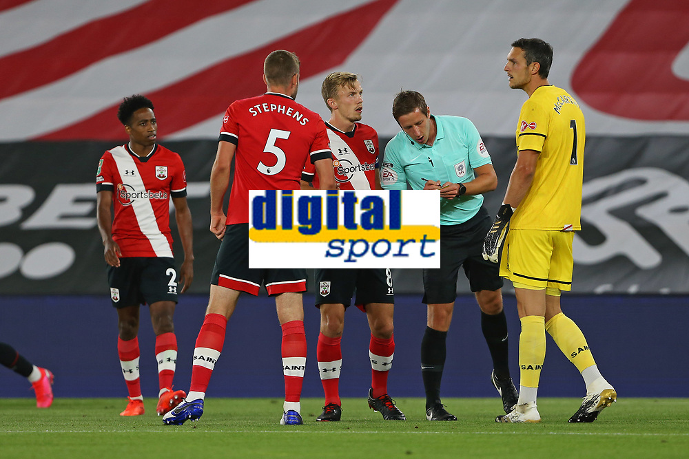 Football - 2020 / 2021 EFL Cup - Round 2 -Southampton vs. Brentford <br /> <br /> Referee Mr John Brooks checks Southampton's Alex McCarthy number before booking the Saints goal keeper during the EFL cup tie at St Mary's Stadium Southampton<br /> <br /> COLORSPORT/SHAUN BOGGUST