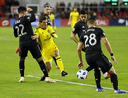 November 1, 2018 - Washington, DC, USA - Columbus Crew SC midfielder Justin Meram (9) tries to sneak between D.C. United midfielder Yamil Asad (22) and defender Joseph Mora (28) during the first half of the MLS Cup knockout round playoff match at Audi Field in Washington, D.C., on Thursday, Nov. 1, 2018. (Credit Image: © Adam Cairns/Columbus Dispatch/TNS via ZUMA Wire)