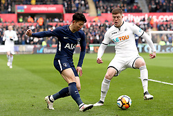 Tottenham Hotspur's Son Heung-Min (left) and Swansea City's Alfie Mawson battle for the ball during the Emirates FA Cup, quarter final match at the Liberty Stadium, Swansea.