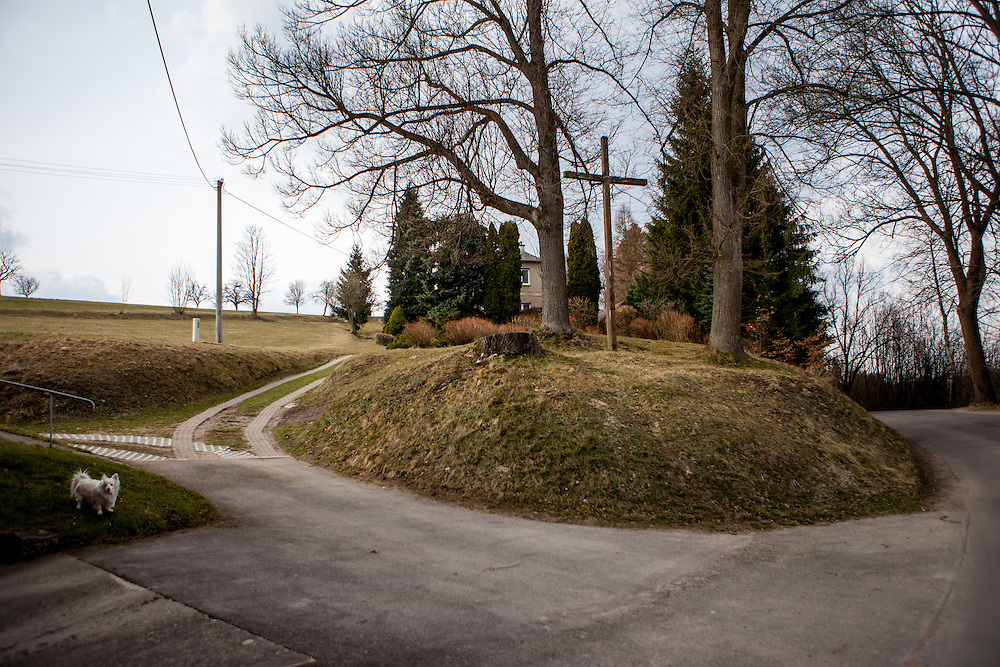 """Probably a former cemetary at the opposite side of the house """"Na Sboru"""". The Unitas Fratrum (Brüdergemeine/Moravian Church) was founded in Kunvald in 1457, when followers of the martyred Jan Hus (John Huss) found refuge on the estate of King George of Poděbrady. Kunvald is a village in 5 km north of Žamberk in the Ústí nad Orlicí District, Pardubice Region of the Czech Republic. It has over 1,000 inhabitants."""