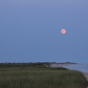 The moon rises at dusk in the height of summer on Cisco Beach, Nantucket, Nantucket Island, Massachusetts, USA. Photo Tim Clayton