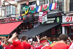 LILLE, FRANCE - Friday, July 1, 2016: Wales fans hang banners from hotels and cafe's in the centre of Lille ahead of the UEFA Euro 2016 Championship Quarter-Final match against Belgium at the Stade Pierre Mauroy. (Pic by Paul Greenwood/Propaganda)