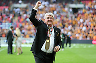 Steve Bruce, the Hull City manager celebrates towards the Hull City fans after k/o. Skybet football league Championship play off final match, Hull city v Sheffield Wednesday at Wembley Stadium in London on Saturday 28th May 2016.<br /> pic by John Patrick Fletcher, Andrew Orchard sports photography.