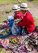 Day 1 of 10 days trekking around Alpamayo: campesino women sell knit hats in Huaripampa Valley, near Vaqueria, in the Cordillera Blanca, Andes Mountains, Peru, South America.