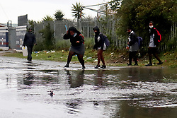 South Africa - Cape Town - 17 August 2020 - Residents and school Pupils from Khayelitsha navigating their across the flooded streets. Photographer: Lubabalo Poswa/African News Agency(ANA)