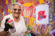 08/09/2015 - Lisbon, Portugal: Isaura Santos Costa, 90, using a stencil with the shape of her hand during the Lata 65 workshop. Lata 65 was project created by Lara Seixo Rodrigues and is a creative workshop teaching street art to senior citizens. (Eduardo Leal)