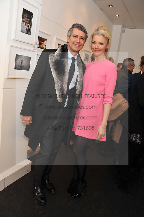 TAMARA BECKWITH and CARLOS SOUZA at a private view of photographs by Anthony Souza held at The Little Black Gallery, 13A Park Walk, London SW10 on 13th December 2011.