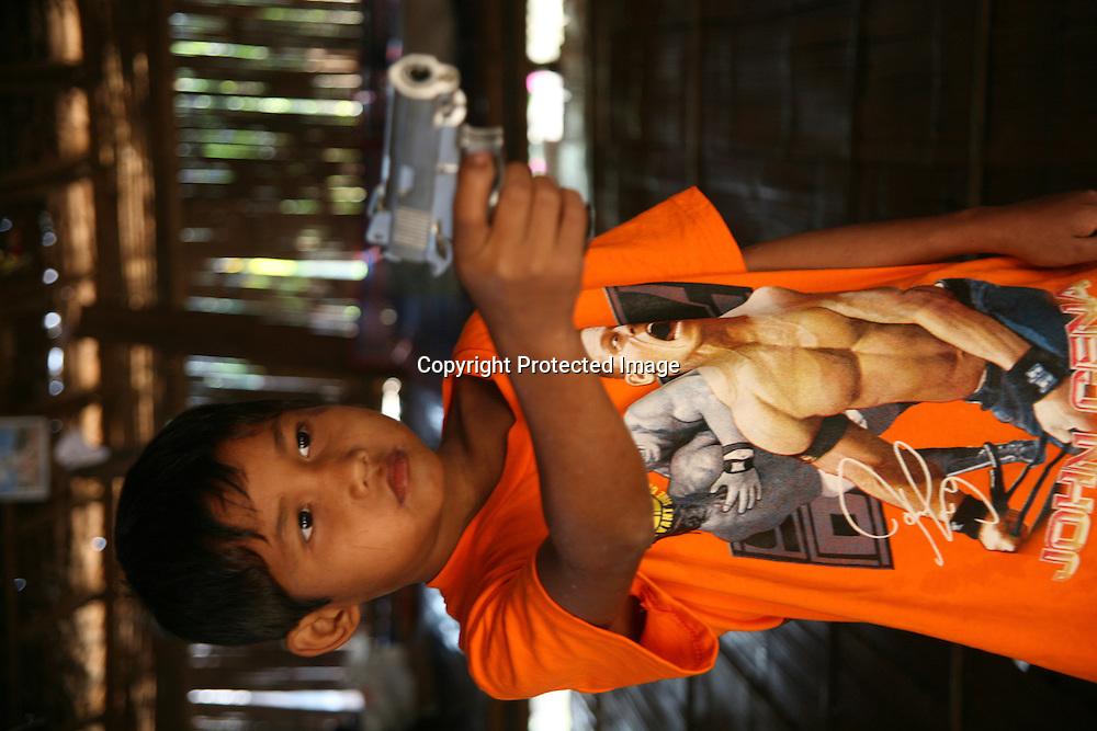 Thai kid with toy gun