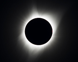 A total solar eclipse is seen on Monday, August 21, 2017 above Madras, Oregon. A total solar eclipse swept across a narrow portion of the contiguous United States from Lincoln Beach, Oregon to Charleston, South Carolina. A partial solar eclipse was visible across the entire North American continent along with parts of South America, Africa, and Europe.  Photo Credit: (NASA/Aubrey Gemignani)  Please note: Fees charged by the agency are for the agency's services only, and do not, nor are they intended to, convey to the user any ownership of Copyright or License in the material. The agency does not claim any ownership including but not limited to Copyright or License in the attached material. By publishing this material you expressly agree to indemnify and to hold the agency and its directors, shareholders and employees harmless from any loss, claims, damages, demands, expenses (including legal fees), or any causes of action or allegation against the agency arising out of or connected in any way with publication of the material.