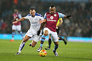 Jordan Ayew of Aston Villa ® holds off Danny Drinkwater of Leicester city. Barclays Premier league match, Aston Villa v Leicester city at Villa Park in Birmingham, The Midlands on Saturday 16th January 2016.<br /> pic by Andrew Orchard, Andrew Orchard sports photography.