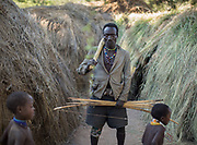Isaya ready to go get honey and hunt. At the Hadza camp of Senkele.