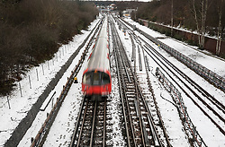 © Licensed to London News Pictures. 11/12/2017. London, UK. A tube train arrives at Stanmore station on snow covered tracks. Disruption continues after yesterday's heavy snowfalls in some parts of the UK.  Photo credit: Peter Macdiarmid/LNP