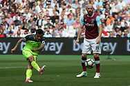 Philippe Coutinho of Liverpool (L) scores his teams third goal. Premier league match, West Ham Utd v Liverpool at the London Stadium, Queen Elizabeth Olympic Park in London on Sunday 14th May 2017.<br /> pic by Steffan Bowen, Andrew Orchard sports photography.