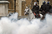 London, England, 15/09/2004..An estimated 20,000 hunt supporters demonstrate in Parliament Square as a new bill to ban hunting with dogs is passed. Some demonstrators fought with riot police, and five hunt supporters managed to get onto the House of Commons floor during the debate. A smoke bonb explodes besdie police horses guarding Parliament.