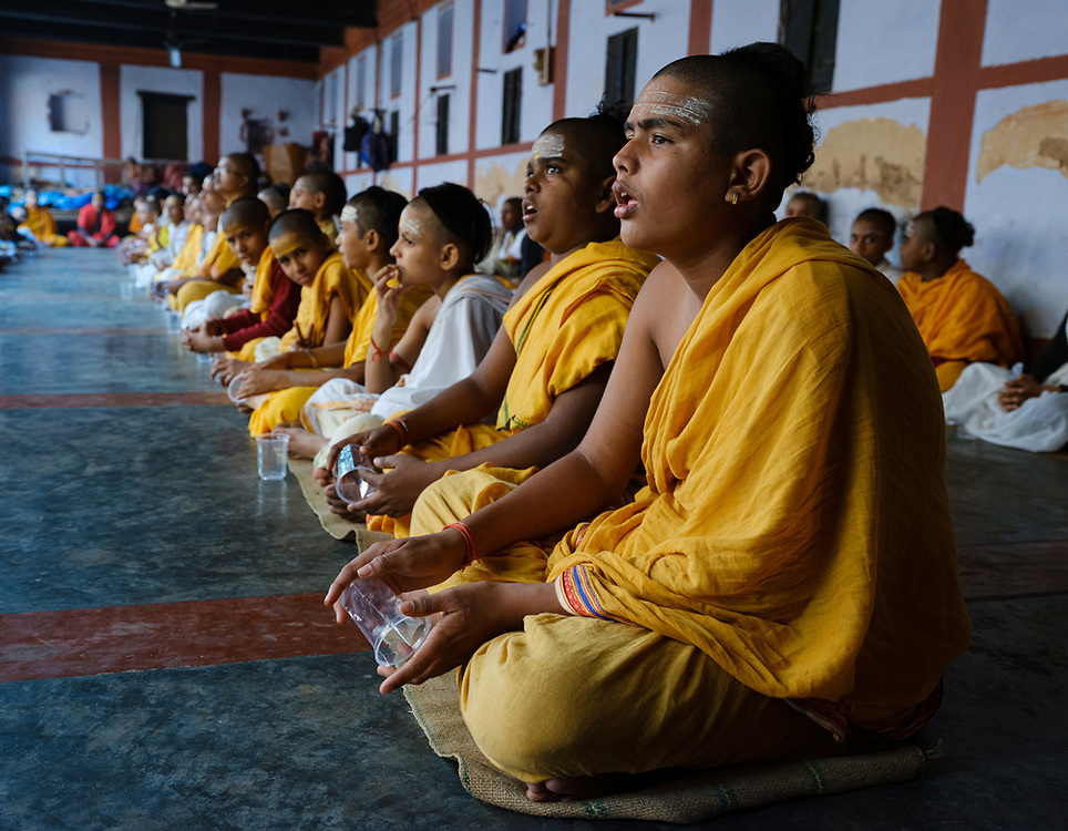Varanasi, INDIA - CIRCA NOVEMBER 2018: Young students at the Panchayati Akhara Shri Niranjani Temple in Varanasi.  Varanasi is the spiritual capital of India, the holiest of the seven sacred cities and with that many rituals and offerings are performed daily by priests and hindus.