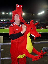 CARDIFF, WALES - Monday, October 9, 2017: A young Wales supporter dressed as a dragon ahead of the 2018 FIFA World Cup Qualifying Group D match between Wales and Republic of Ireland at the Cardiff City Stadium. (Pic by Paul Greenwood/Propaganda)
