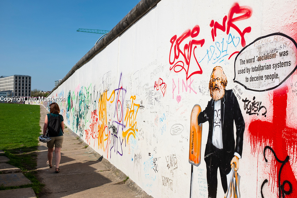View of original section of Berlin Wall with graffiti at East Side Gallery in Friedrichshain, Berlin, Germany