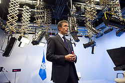 Anders Fogh Rasmussen, the secretary general of the North Atlantic Treaty Organization, prepares for a live television interview at NATO headquarters, in Brussels, Belgium, on Monday August 31, 2009. (Photo © Jock Fistick)
