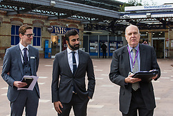 Maidenhead, UK. 11th October, 2021. Cllr Gerry Clark (r), the Royal Borough of Windsor and Maidenhead's cabinet member for transport and infrastructure, speaks at the opening of a new Maidenhead station forecourt. The £3.75m refurbishment is intended to make the area around the station more commuter-friendly in anticipation of an increase in passengers when Crossrail opens and to improve both the interchange between trains and other forms of transport and walking and cycling links between the station and the town centre.