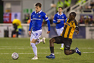Oldham Athletic forward Callum Lang (19) and Maidstone United midfielder Olumide Durojaiye (17) during the The FA Cup match between Maidstone United and Oldham Athletic at the Gallagher Stadium, Maidstone, United Kingdom on 1 December 2018. Photo by Martin Cole