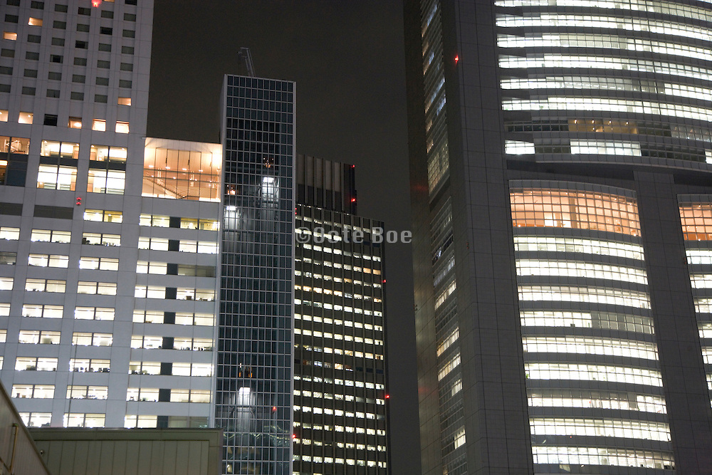 various high rise buildings illuminated by night Tokyo