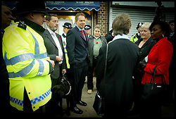 The British Prime Minister Tony Blair and David Blunkett meet residents as they  walk the streets of Falonwood Nr Welling, with Police Constable  Support Oficer Tracey Bush,Today Tuesday 9th November 2004 on the day the Government annouce A Police reform policy Paper  .PA Photo Andrew Parsons WPA POOL