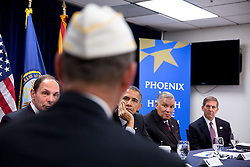 President Barack Obama and Veterans Affairs Secretary Robert A. McDonald, left, meet with veterans, VA employees and representatives from veterans groups for a briefing on the progress made to improve the Department of Veterans Affairs' ability to serve veterans in a timely and effective manner, at the Phoenix VA Medical Center in Phoenix, Ariz., March 13, 2015. (Official White House Photo by Pete Souza)<br /> <br /> This official White House photograph is being made available only for publication by news organizations and/or for personal use printing by the subject(s) of the photograph. The photograph may not be manipulated in any way and may not be used in commercial or political materials, advertisements, emails, products, promotions that in any way suggests approval or endorsement of the President, the First Family, or the White House.