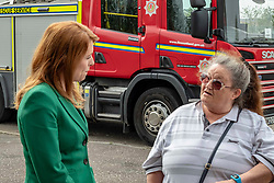 EMBARGOED UNTIL 00:01 24 April 2019<br />Pictured: Ash Denham discusses the problems of fire safety Agnes Moiers, thirds floor resident of neighbouring Greendykes House whose nieces used to use the nursery on the ground floor of Grenfell Tower<br /><br />Today, Community Safety minister Ash Denham launched the Scottish Government's consultation on Strengthening Fire Safety for High Rise Domestic Buildings following the Grenfell Tower fire in London.  Ms Denholm was joined by Assistant Chief Fire Officer Ross Haggart and Mark McHale, building manager of Wauchope House, <br /><br /><br />Ger Harley | EEm 23 April 2019