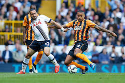 Nacer Chadli of Tottenham Hotspur is challenged by Tom Huddlestone of Hull City - Photo mandatory by-line: Rogan Thomson/JMP - 07966 386802 - 16/05/2015 - SPORT - FOOTBALL - London, England - White Hart Lane - Tottenham Hotspur v Hull City - Barclays Premier League.